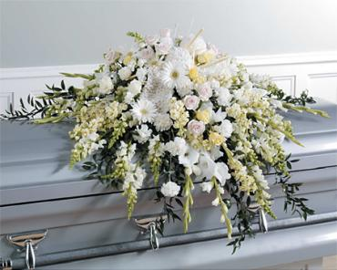 A White Casket Spray/Snaps,Glads,Stock,Carns,Roses
