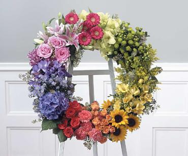 Multi-colored Wreath on easel/Glads,Hypericum,Roses,Gerbs,Carns,