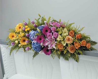 A Rainbow Full Couch Spray/Lillies,Hydrangea,Gerb,Roses,Tulips