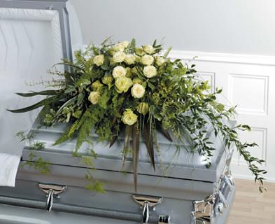 A Foilage and Rose Casket Spray