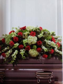 A Peaceful Casket Spray/Carns,Larkspur,Roses,Hydrangea